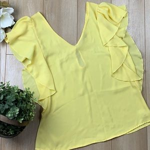 Penelope yellow v-neck blouse